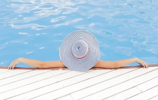 relaxing in the pool because energy costs are low